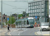 SK5236 : Tram on test passing Central College by Alan Murray-Rust