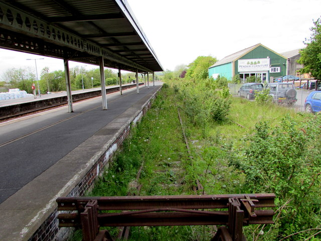 Weeds cover a long disused line of the north side of Whitland railway station