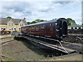 TL0997 : Railway carriage and turntable at Wansford Station by Richard Humphrey