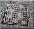 C1038 : Manhole cover, Downings by Rossographer