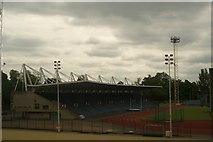 TQ3470 : View of the athletics track and Jubilee Stand from the walkway into the National Sports Centre by Robert Lamb