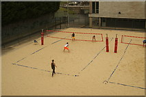 TQ3470 : View of two men and two women playing a beach volleyball match at the National Sports Centre by Robert Lamb