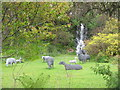 NM7417 : Waterfall and sheep at An Cala by M J Richardson