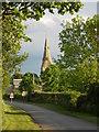 TF1406 : View along Main Road towards Etton church by Paul Bryan