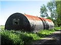 TM1475 : Romney hut beside farm track by Evelyn Simak