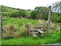 SH5346 : Public footpath signpost and stile, Cwm Pennant by Christine Johnstone