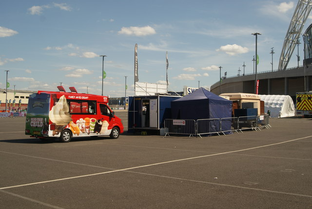 View of an ice cream van and a sweets and waffles stall from the car park on Engineer's Way