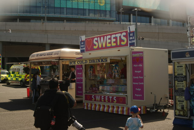 View of a waffle van and a sweets stall in the car park off Engineer's Way