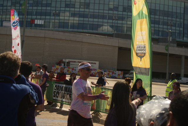 View of the first of the Colour Runners crossing the finish line #3