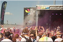 TQ1985 : View of a small colour throw in front of the stage at the Colour Run by Robert Lamb