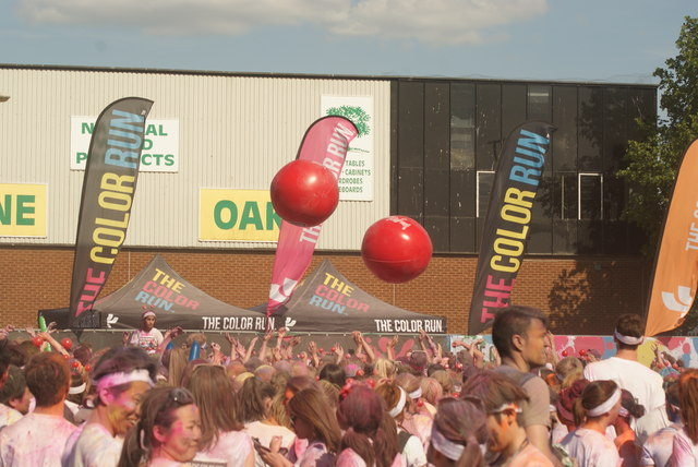 View of two giant volleyballs in the crowd at the Colour Run