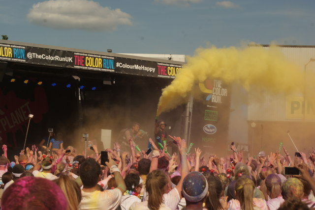 View of the presenter using a colour shooter at the Colour Run #2