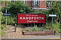 SJ8583 : Station signs, Handforth railway station by El Pollock