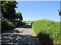 SE7866 : Road north from Kennythorpe by Martin Dawes