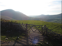 NY2824 : Gate on path on Latrigg, with view to Blencathra by Gareth James