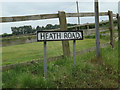 TM0384 : Heath Road sign by Adrian Cable
