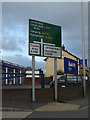 SO1191 : Roadsign on the A483 Pool Road by Adrian Cable