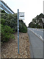 SN5981 : Bus Stop sign on the university entrance road by Adrian Cable