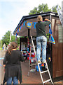 SP9211 : Putting up the yarn fringe round the roof of Tring's Bus Shelter by Chris Reynolds