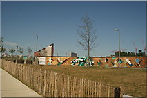 TQ3784 : View of a colourful wall next to Loop Road from the River Lea Navigation by Robert Lamb