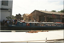 TQ3784 : View of a crowd of people at the rear of the Crate Brewery from the River Lea Navigation by Robert Lamb