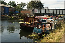 TQ3784 : View of two boats moored up on the River Lea near the London Overground bridge by Robert Lamb
