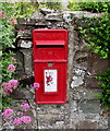 SN3609 : Queen Elizabeth II postbox in a Ferryside wall by Jaggery