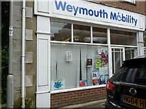 SY6778 : Benchmark on Weymouth Mobility Shop by Becky Williamson