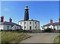 TR0816 : Old lighthouse and cottages, Dungeness by Chris Allen