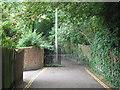 TQ3975 : Barrier on Heath Lane by Stephen Craven