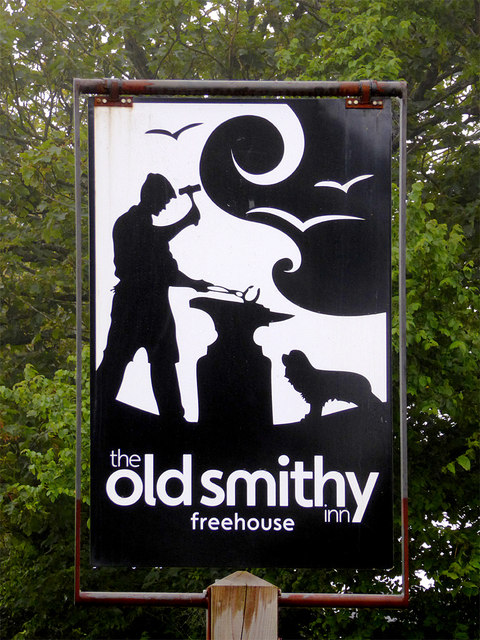 The Old Smithy Inn sign  at Darracott, Devon