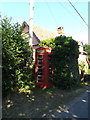 TM1768 : Telephone Box on The Street by Adrian Cable