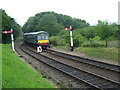 TG1141 : A DMU approaches Weybourne station by Marathon