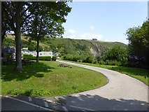 SX5646 : Stoke Beach caravan park and cliffs beyond by David Smith