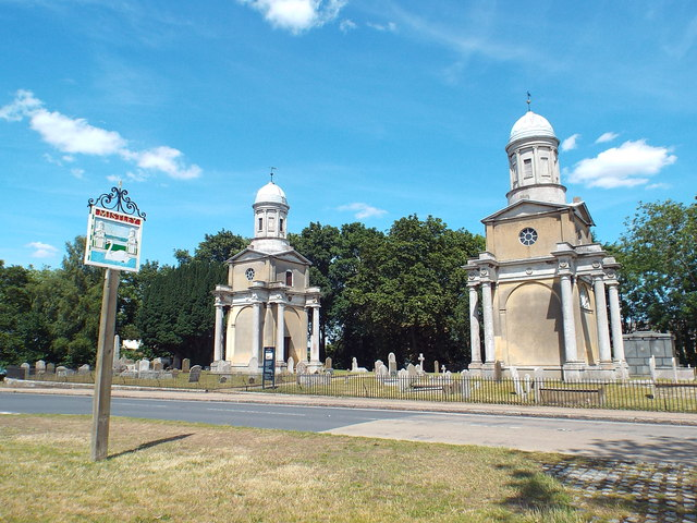 Mistley Towers and village sign