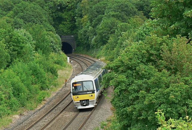 Chiltern Railways diesel unit leaving the west portal of White House Farm Tunnel