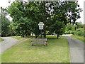 TG0337 : Sharrington village sign by Adrian S Pye