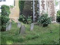 TQ3089 : Gravestones at the foot of St. Mary's Tower, Hornsey (2) by Mike Quinn