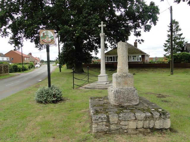 Old broken preaching cross and Wormegay War Memorial