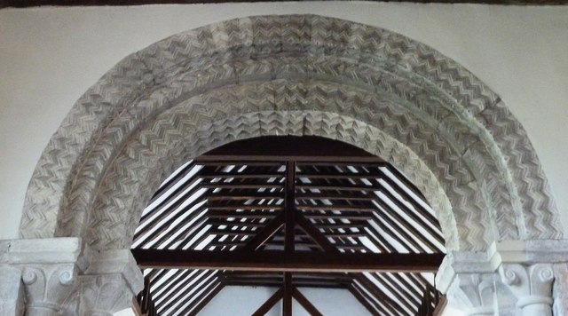 Romanesque style carving on Norman chancel arch