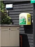 TM1369 : Defibrillator at Thorndon Community shop by Adrian Cable