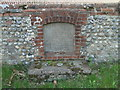 TG3131 : Edingthorpe WW2 memorial in the wall of Green Farm by Adrian S Pye