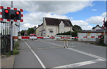 SN1916 : Station Road level crossing barriers down, Whitland by Jaggery