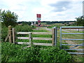 TQ8917 : Foot crossing over the Marshlink Line by Marathon