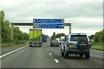 SJ7466 : Motorway sign gantry over the M6 by Steve Daniels
