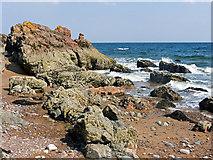 NH7661 : Black Isle coastline below Craighead by Julian Paren