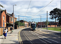 SK5236 : Tram leaving Beeston Centre by John Sutton