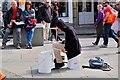 NT2573 : Street performer in the Grassmarket (1) by Jim Barton