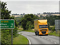 TF9130 : Yellow HGV on A1065 near Fakenham by David Dixon