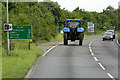 TF9130 : Tractor on the A148 near Fakenham by David Dixon